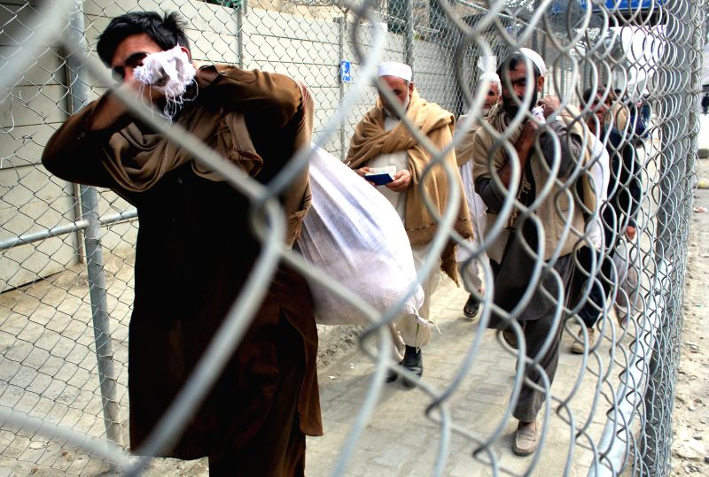 TORKHAM (PAKISTAN), March 20, 2017 People cross Pakistan-Afghanistan border in northwest Pakistan's Torkham, on March 20, 2017. Pakistani Prime Minister Nawaz Sharif on Monday issued ... - Nawaz Sharif