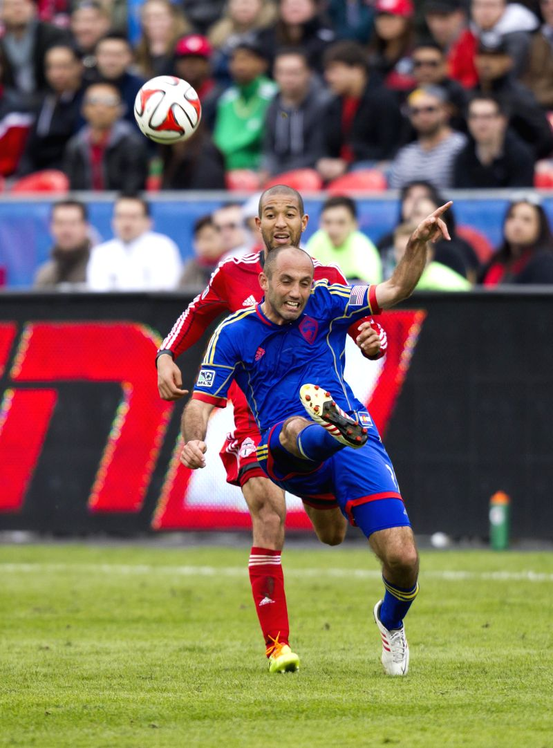 Justin Morrow(2nd, R) of Toronto FC vies with Drew Moor (3rd, R) of Colorado Rapids during their 2014 Major League Soccer (MLS) match in Toronto, Canada, April 12,