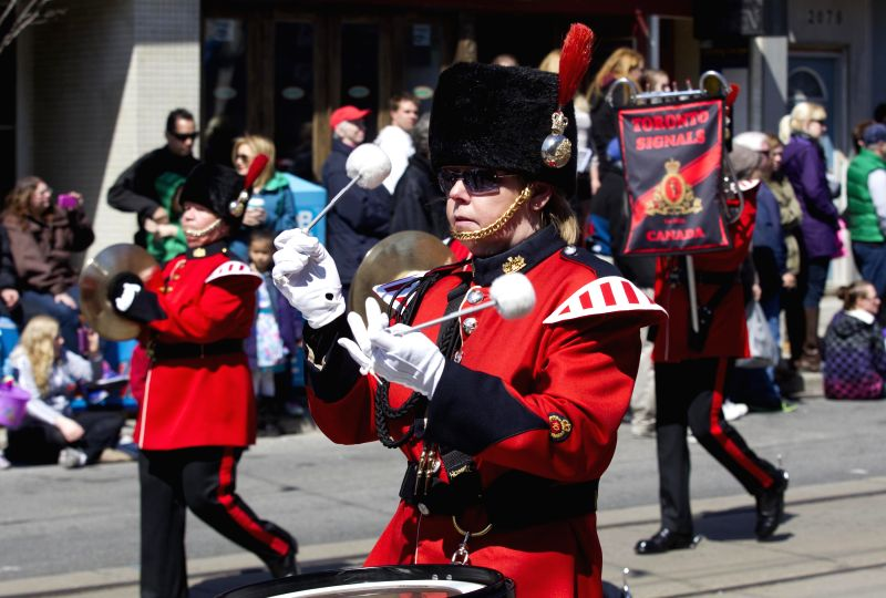 Performers walk down the street during the 2014 Toronto Beaches Lions Easter Parade in Toronto, Canada, April 20, 2014. Photo: