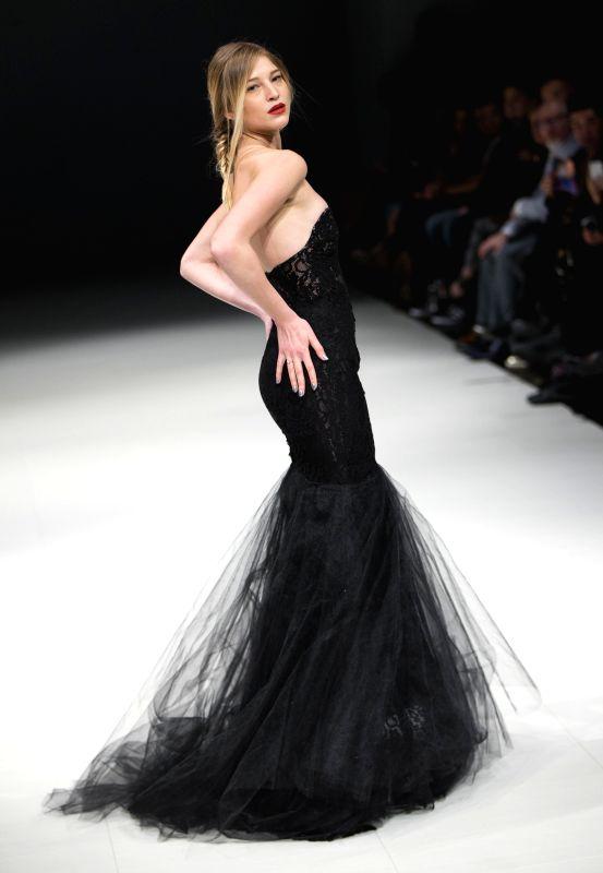 TORONTO, April 21, 2017 - A model presents a creation by Steven Lejambe during the 2017 Fashion Art Toronto event in Toronto, Canada, April 20, 2017. (Xinhua/Zou Zheng) (zxj/IANS))