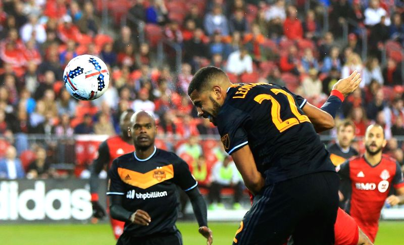 TORONTO, April 29, 2017 - Leonardo (Front) of Houston Dynamo competes during the 2017 Major League Soccer (MLS) match between Toronto FC and Houston Dynamo at BMO Field in Toronto, Canada, April 28, ...