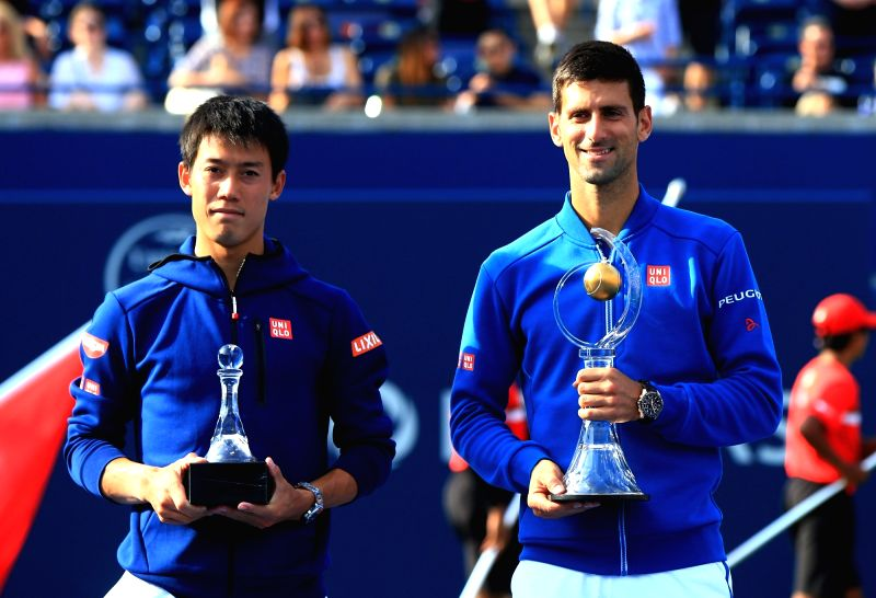 TORONTO, Aug. 1, 2016 - Kei Nishikori(L) of Japan and Novak Djokovic of Serbia pose for photos during the awarding ceremony of the final match of men's singles at the 2016 Rogers Cup in Toronto, ...
