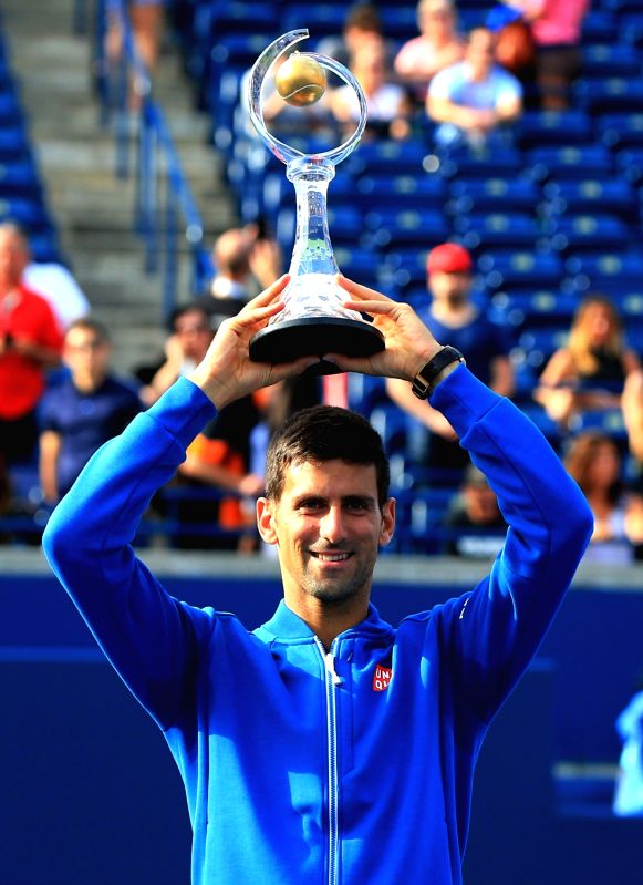 TORONTO, Aug. 1, 2016 - Novak Djokovic of Serbia poses for photos with his champion trophy during the awarding ceremony of the men's singles final at the 2016 Rogers Cup in Toronto, Canada, July 31, ...