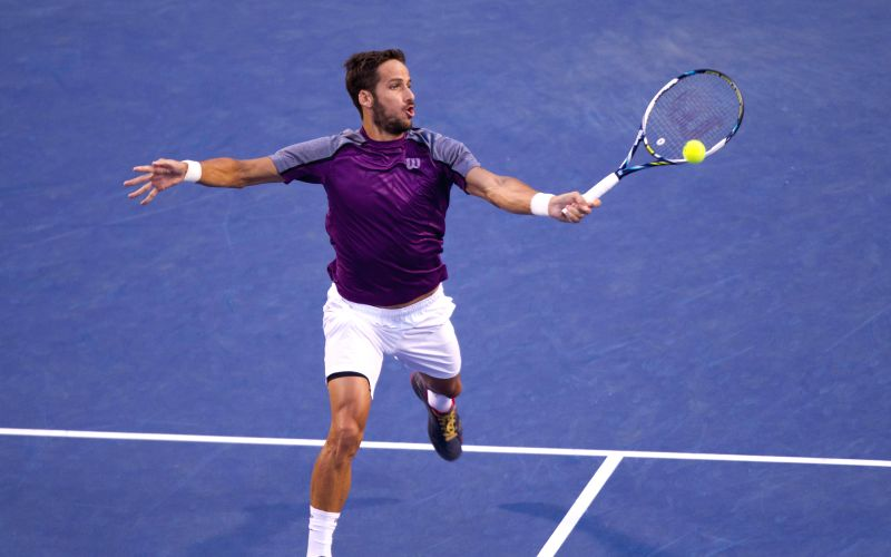 Feliciano Lopez of Spain returns the ball during the semifinal of men's singles against Roger Federer of Switzerland at the 2014 Rogers Cup in Toronto, Canada, Aug.