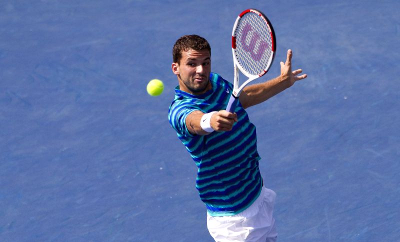 Grigor Dimitrov of Bulgaria returns the ball during the semifinal of men's singles against Jo-Wilfried Tsonga of France at the 2014 Rogers Cup in Toronto, Canada, ..