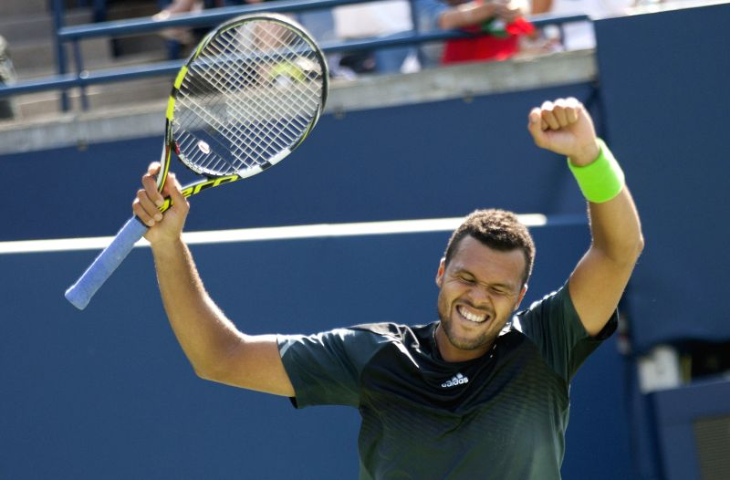 Jo-Wilfried Tsonga of France celebrates victory after the semifinal of men's singles against Grigor Dimitrov of Bulgaria at the 2014 Rogers Cup in Toronto, Canada, .