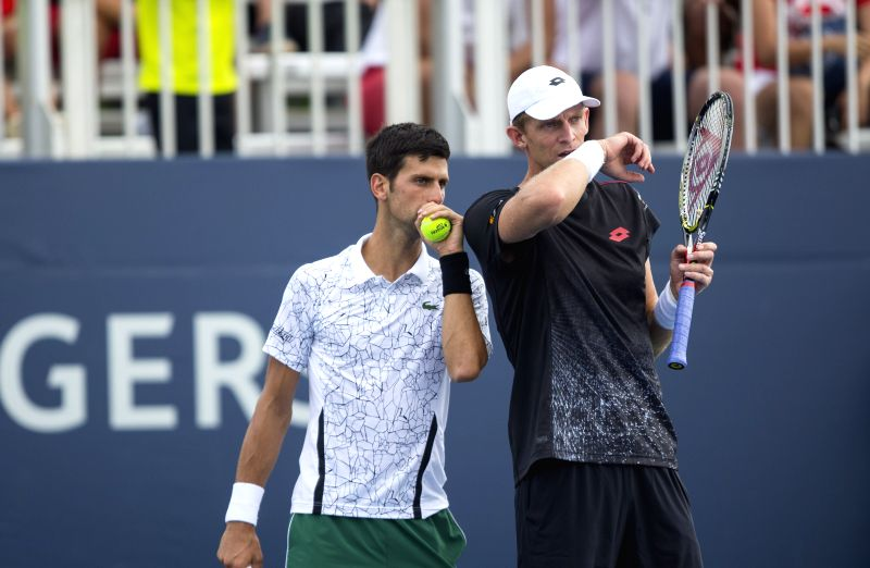 TORONTO, Aug. 10, 2018 - Novak Djokovic (L) of Serbia and Kevin Anderson of South Africa react during the second round of men's doubles match against Pierre-Hugues Herbert/Nicolas Mahut of France at ...