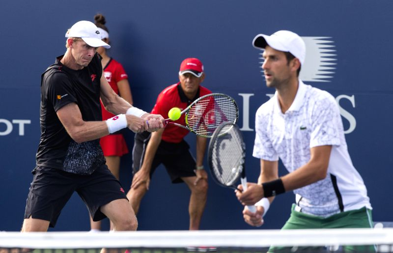 TORONTO, Aug. 10, 2018 - Novak Djokovic (R) of Serbia and Kevin Anderson of South Africa compete during the second round of men's doubles match against Pierre-Hugues Herbert/Nicolas Mahut of France ...
