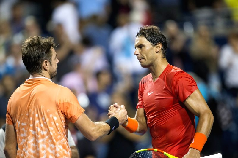 TORONTO, Aug. 10, 2018 - Rafael Nadal (R) of Spain shakes hands with Stan Wawrinka of Switzerland after their third round of men's singles match at the 2018 Rogers Cup in Toronto, Canada, Aug. 9, ...