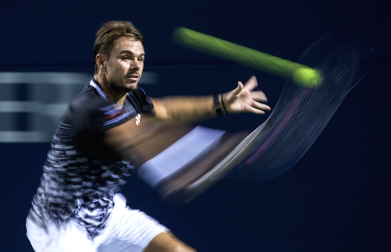 TORONTO, Aug. 10, 2018 - Stan Wawrinka of Switzerland hits a return during the men's singles third round match against Rafael Nadal of Spain at the 2018 Rogers Cup in Toronto, Canada, Aug. 9, 2018. ...