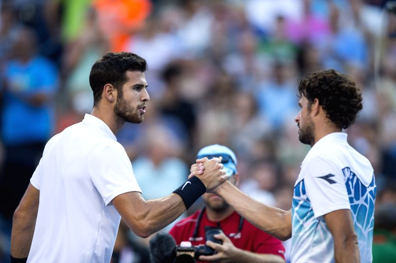 TORONTO, Aug. 11, 2018 - Karen Khachanov (L) of Russia shakes hands with Robin Haase of the Netherlands after their quarterfinal match of men's singles at the 2018 Rogers Cup in Toronto, Canada, Aug. ...