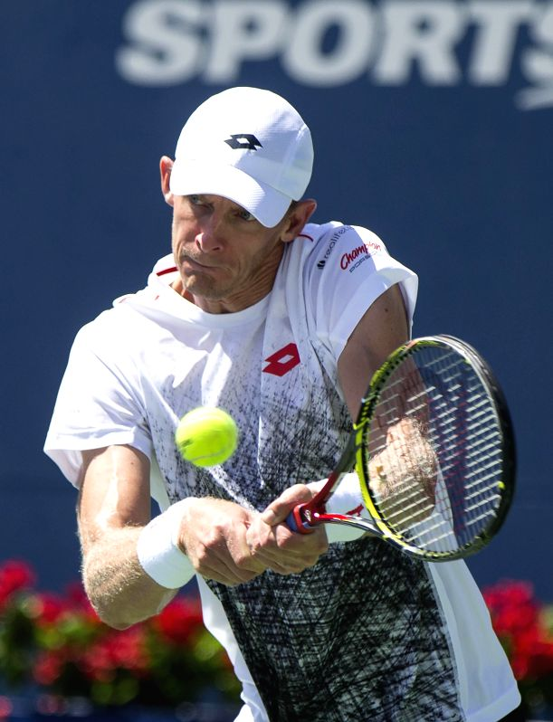TORONTO, Aug. 11, 2018 - Kevin Anderson of South Africa returns the ball against Grigor Dimitrov of Bulgaria during the quarterfinal match of men's singles at the 2018 Rogers Cup in Toronto, Canada, ...