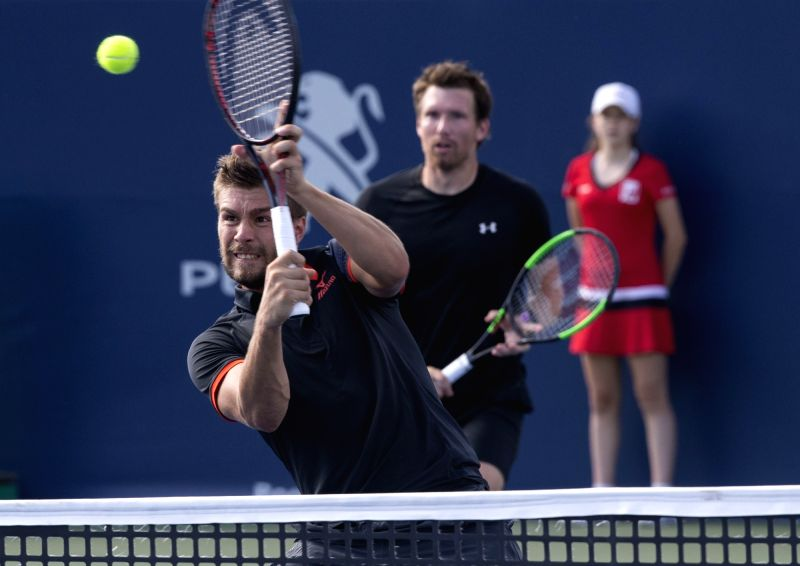 TORONTO, Aug. 11, 2018 - Nikola Mektic (Front) of Croatia and Alexander Peya of Austria compete during the quarterfinal match of men's doubles against Novak Djokovic of Serbia and Kevin Anderson of ...