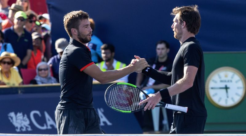 TORONTO, Aug. 11, 2018 - Nikola Mektic (L) of Croatia and Alexander Peya of Austria celebrate victory after the quarterfinal match of men's doubles against Novak Djokovic of Serbia and Kevin Anderson ...