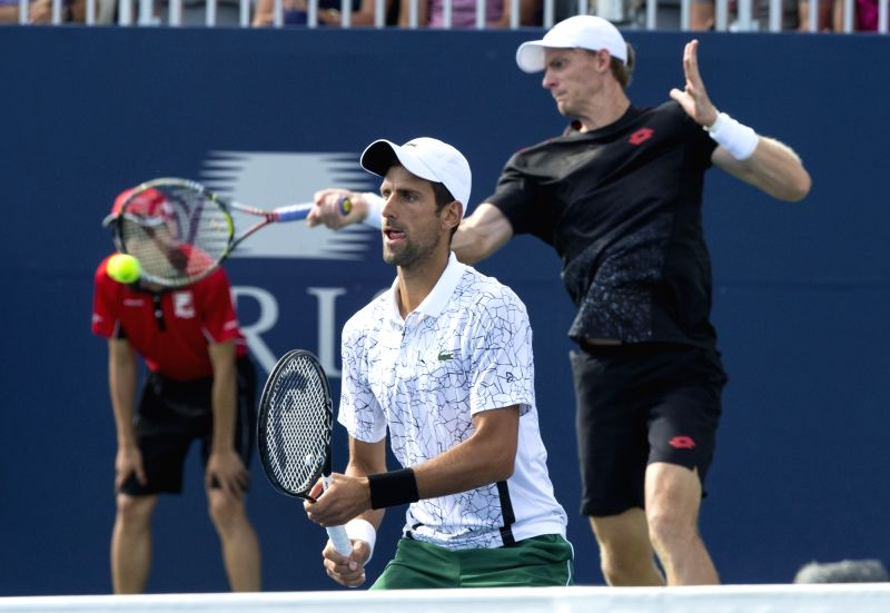 TORONTO, Aug. 11, 2018 - Novak Djokovic (Front) of Serbia and Kevin Anderson of South Africa compete during the quarterfinal match of men's doubles against Nikola Mektic of Croatia and Alexander Peya ...