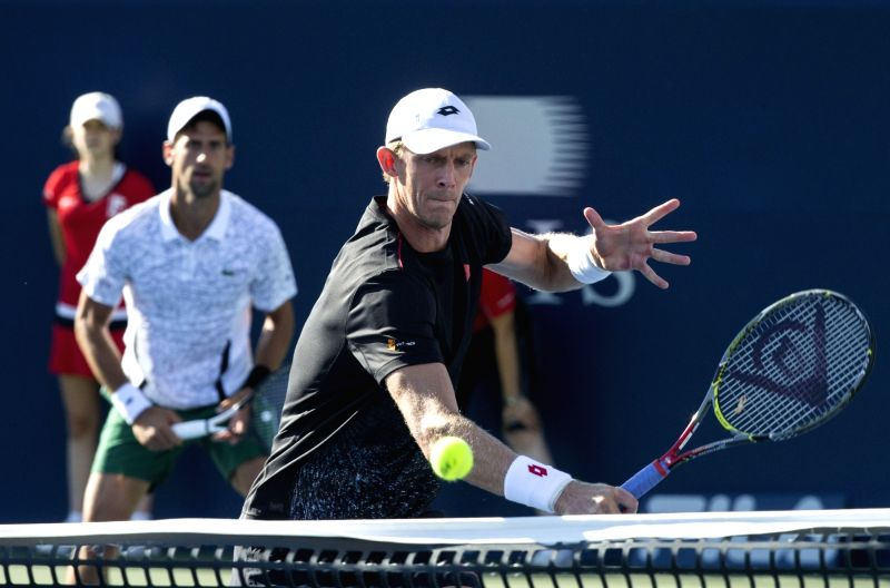TORONTO, Aug. 11, 2018 - Novak Djokovic of Serbia and Kevin Anderson (Front) of South Africa compete during the quarterfinal match of men's doubles against Nikola Mektic of Croatia and Alexander Peya ...