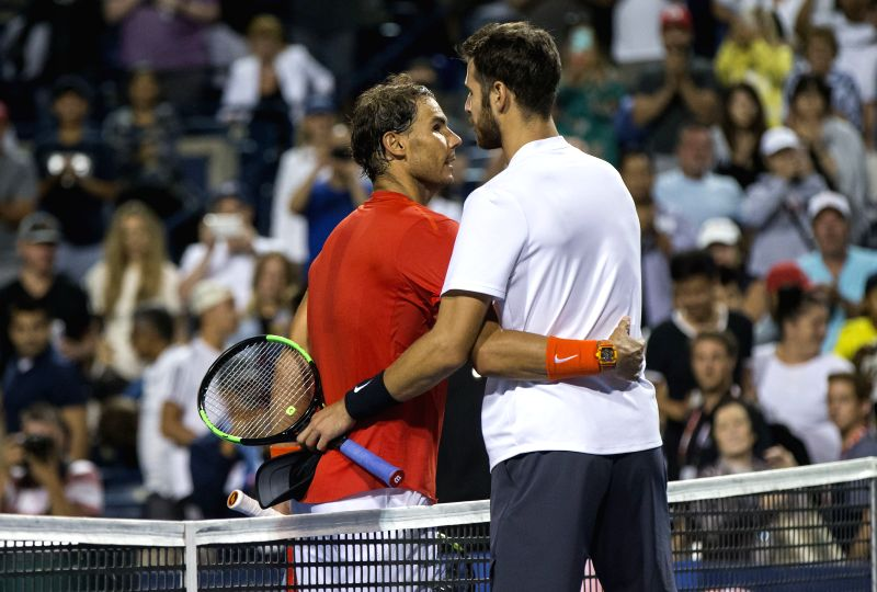TORONTO, Aug. 12, 2018 - Karen Khachanov(R) of Russia congratulates Rafael Nadal of Spain after their semifinal match of men's singles at the 2018 Rogers Cup in Toronto, Canada, Aug. 11, 2018. Rafael ...