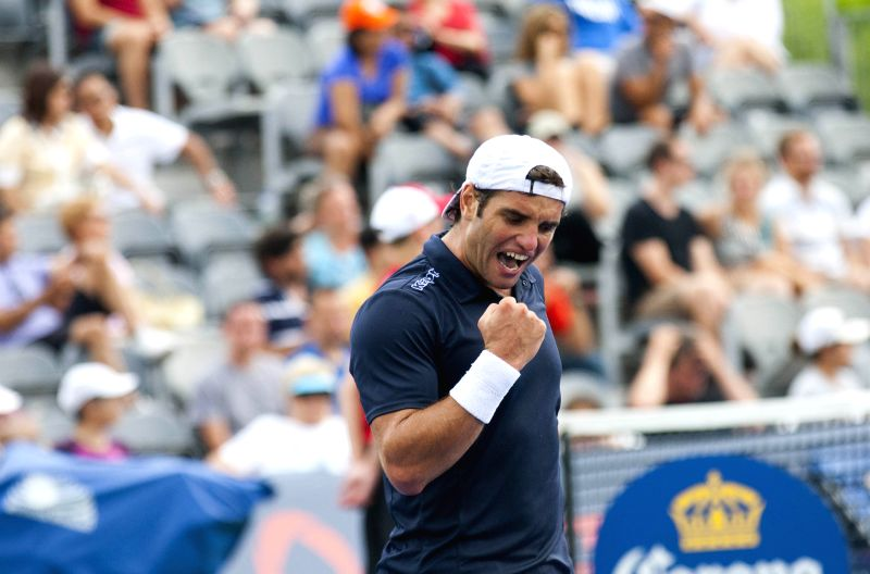 Malek Jaziri of Tunisia celebrates scoring during the first round of men's singles qualifying match against Filip Peliwo of Canada at the 2014 Rogers Cup in Toronto,