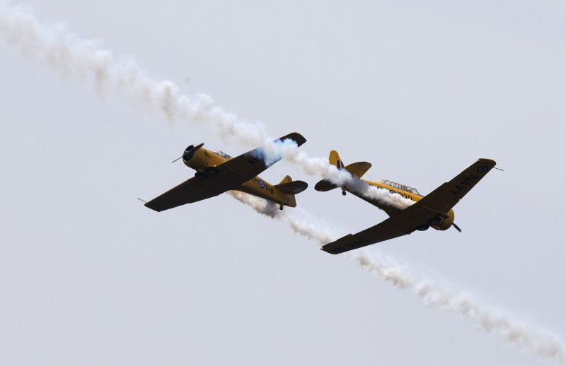 Harvards planes perform perform during the 65th Canadian International Air Show in Toronto, Canada, Aug. 30, 2014. Kicked off on Saturday, the three-day annual ...