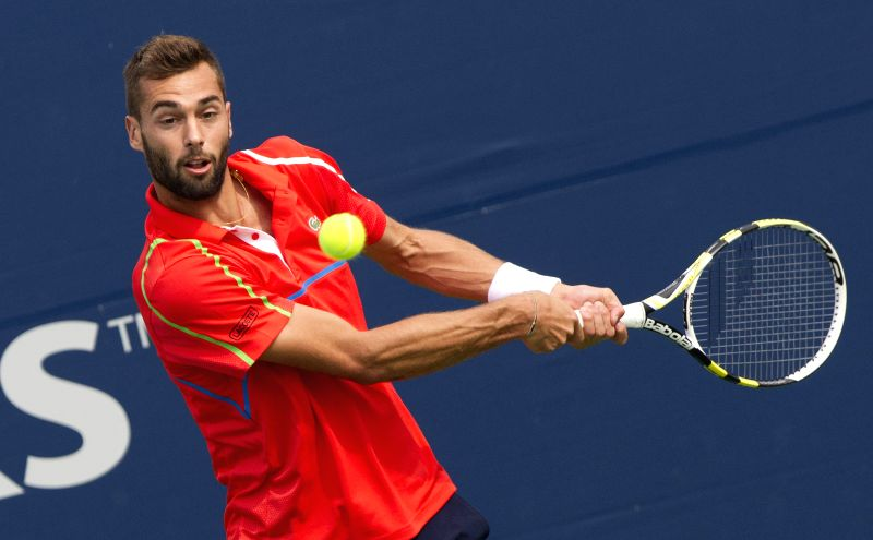 Benoit Paire of France returns the ball during the second round of men's singles qualifying match against James Duckworth of Australia at the 2014 Rogers Cup in ...