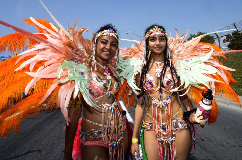 TORONTO, Aug. 4, 2018 - Dressed-up revelers are seen during the 2018 Peeks Toronto Caribbean Carnival Grand Parade in Toronto, Canada, on Aug. 4, 2018. Kicking off on Saturday, the annual event ...