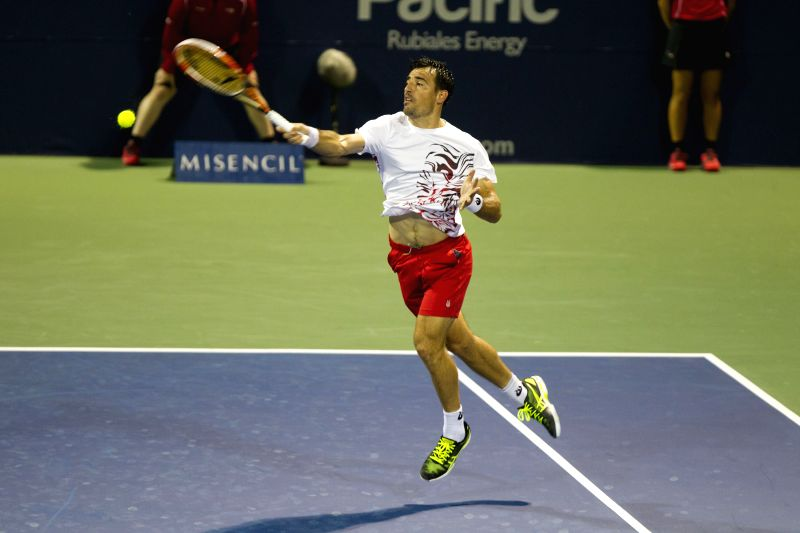 Ivan Dodig of Croatia returns the ball during the first round of men's singles against John Isner of the United States at the 2014 Rogers Cup in Toronto, Canada, ...