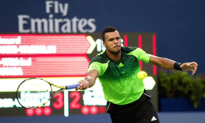 Jo-Wilfried Tsonga of France returns the ball during the first round of men's singles against Edouard Roger-Vasselin of France at the 2014 Rogers Cup in Toronto, ...