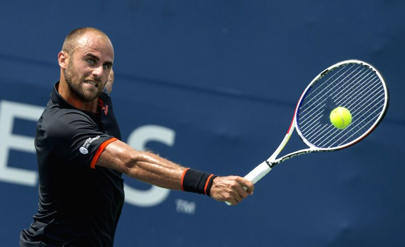 TORONTO, Aug. 5, 2018 - Marius Copil of Romania returns the ball against Yoshihito Nishioka of Japan during the first round of men's singles qualifying match at the 2018 Rogers Cup in Toronto, ...