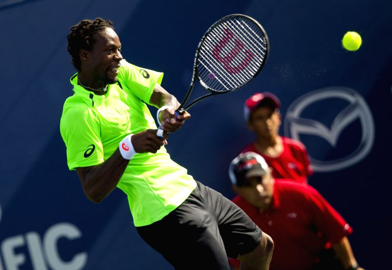 Gael Monfils of France returns the ball during the first round of men's singles against Radek Stepanek of the Czech Republic at the 2014 Rogers Cup in Toronto, ...