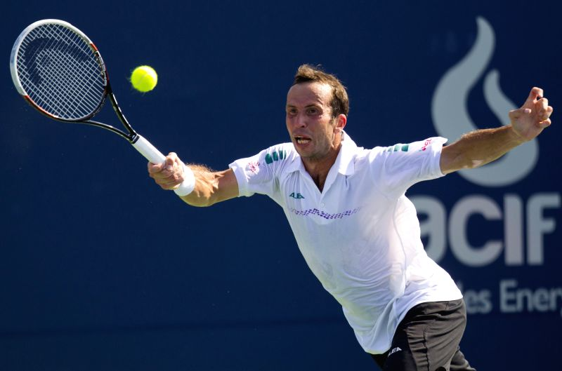 Radek Stepanek of the Czech Republic returns the ball during the first round of men's singles against Gael Monfils of France at the 2014 Rogers Cup in Toronto, ...