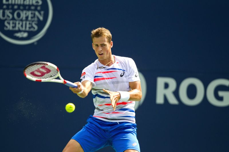 Vasek Pospisil of Canada returns the ball during the first round of men's singles against Richard Gasquet of France at the 2014 Rogers Cup in Toronto, Canada, Aug. 5,