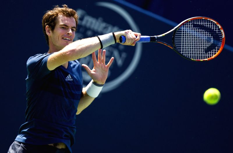 Andy Murray of Britain returns the ball during the second round of men's singles against Nick Kyrgios of Australia at the 2014 Rogers Cup in Toronto, Canada, Aug. 6,