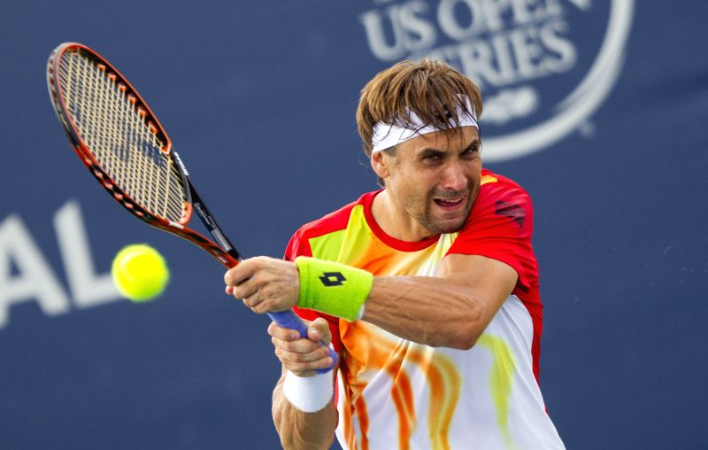 David Ferrer of Spain returns the ball during the second round of men's singles against Michael Russell of the United States at the 2014 Rogers Cup in Toronto, ...
