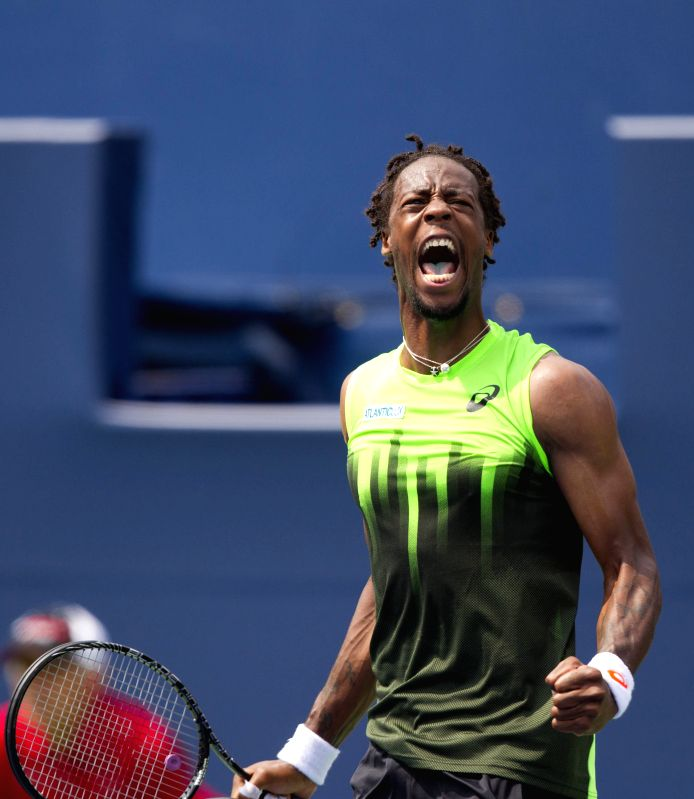 Gael Monfils of France celebrates scoring during the second round of men's singles against Novak Djokovic of Serbia at the 2014 Rogers Cup in Toronto, Canada, Aug. ..