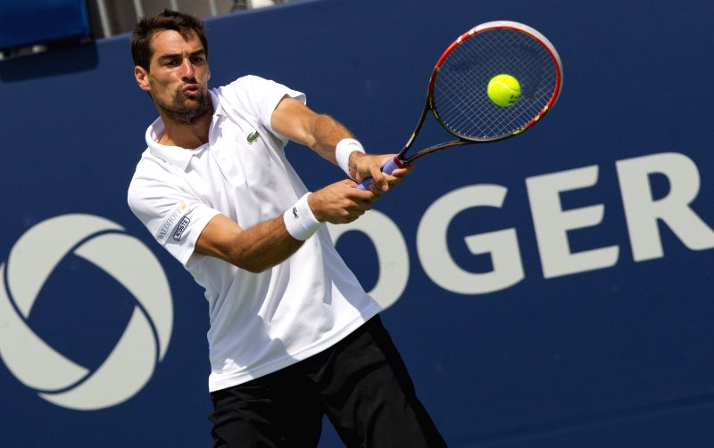 Jeremy Chardy of France returns the ball during the second round of men's singles against Jo-Wilfried Tsonga of France at the 2014 Rogers Cup in Toronto, Canada, ...
