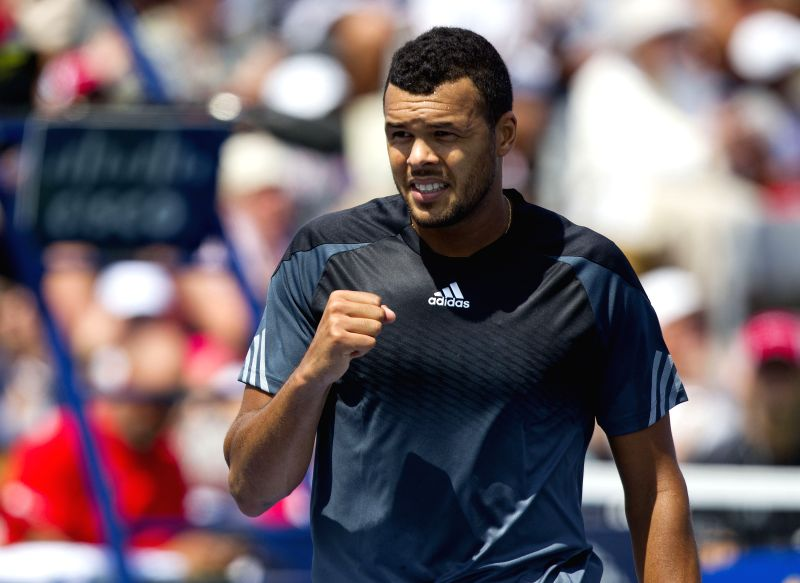 Jo-Wilfried Tsonga of France celebrates scoring during the second round of men's singles against Jeremy Chardy of France at the 2014 Rogers Cup in Toronto, Canada, ..