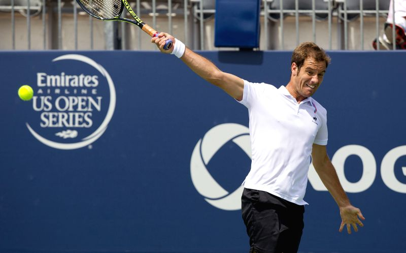 Richard Gasquet of France returns the ball during the second round of men's singles against Ivo Karlovic of Croatia at the 2014 Rogers Cup in Toronto, Canada, Aug. ..