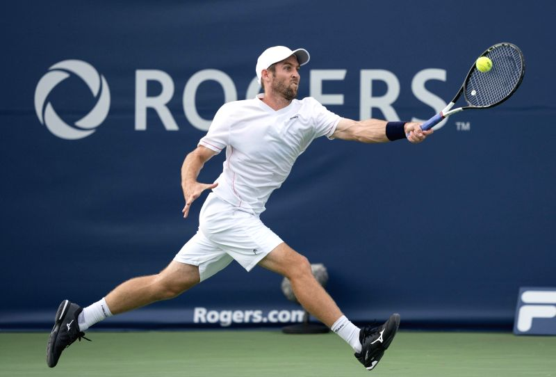 TORONTO, Aug. 7, 2018 - Bradley Klahn of the United States hits a return during the first round of men's singles match against David Ferrer of Spain at the 2018 Rogers Cup in Toronto, Canada, Aug. 6, ...
