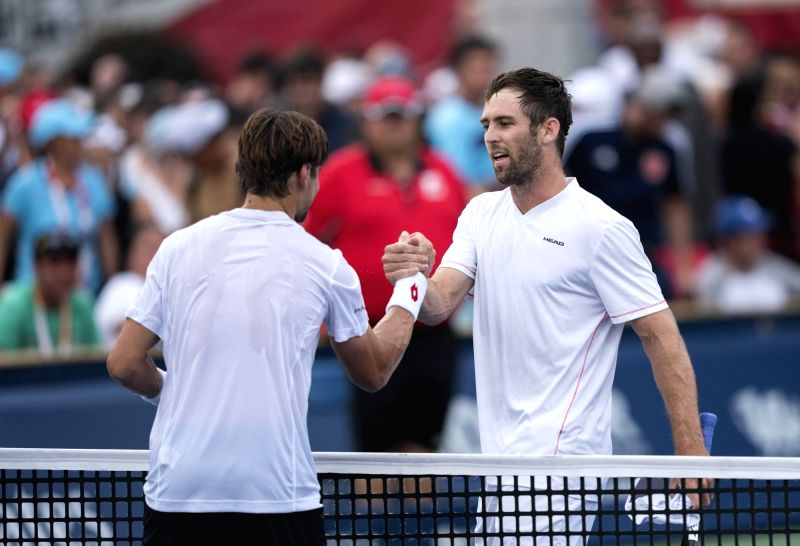 TORONTO, Aug. 7, 2018 - Bradley Klahn (R) of the United States shakes hands with David Ferrer of Spain after their first round of men's singles match at the 2018 Rogers Cup in Toronto, Canada, Aug. ...