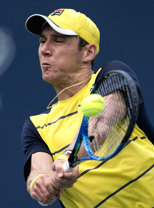 TORONTO, Aug. 7, 2018 - Matthew Ebden of Australia hits a return during the first round of men's singles match against Peter Polansky of Canada at the 2018 Rogers Cup in Toronto, Canada, Aug. 6, ...