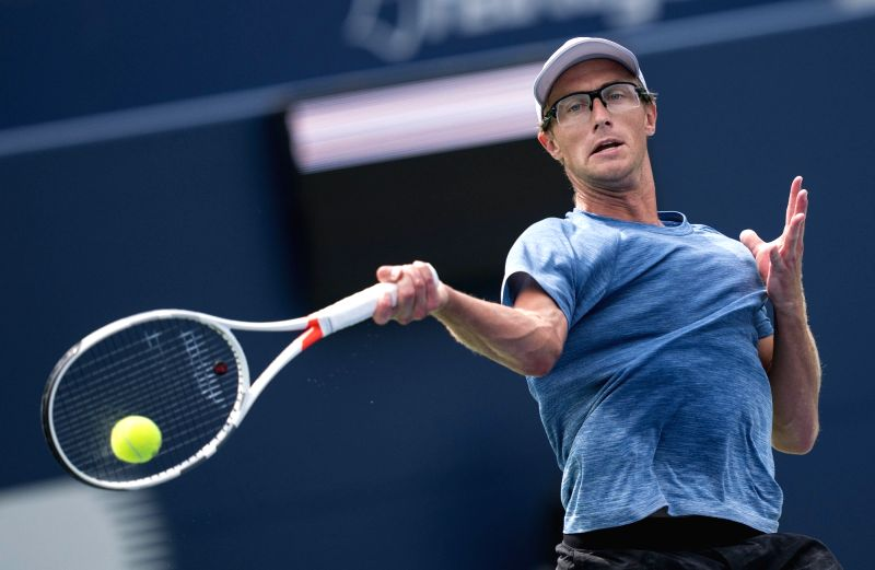 TORONTO, Aug. 7, 2018 - Peter Polansky of Canada hits a return during the first round of men's singles match against Matthew Ebden of Australia at the 2018 Rogers Cup in Toronto, Canada, Aug. 6, ...