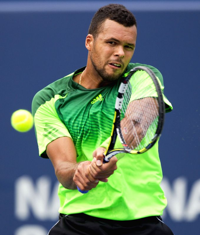 Jo-Wilfried Tsonga of France returns the ball during the third round of men's singles against Novak Djokovic of Serbia at the 2014 Rogers Cup in Toronto, Canada, Aug.