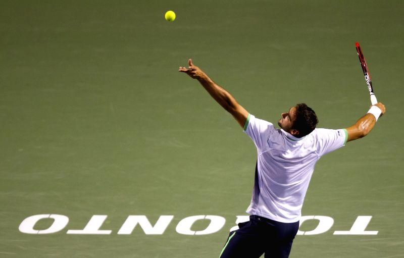 Marin Cilic of Croatia serves during the third round of men's singles against Roger Federer of Switzerland at the 2014 Rogers Cup in Toronto, Canada, Aug. 7, 2014. ...