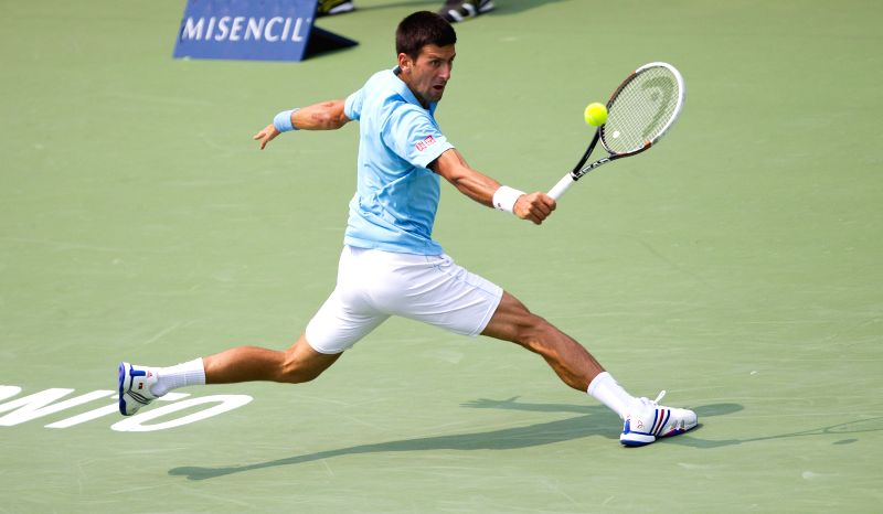 Novak Djokovic of Serbia returns the ball during the third round of men's singles against Jo-Wilfried Tsonga of France at the 2014 Rogers Cup in Toronto, Canada, Aug.