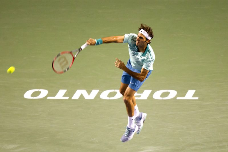 Roger Federer of Switzerland serves during the third round of men's singles against Marin Cilic of Croatia at the 2014 Rogers Cup in Toronto, Canada, Aug. 7, 2014. ...