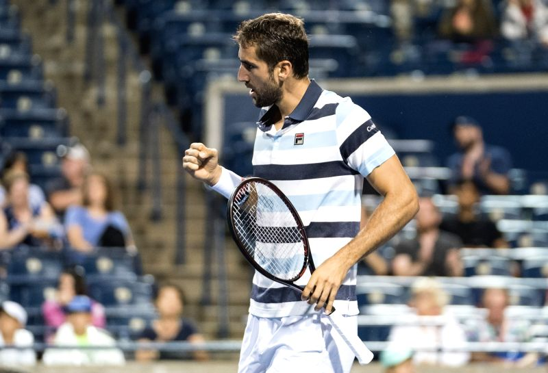 TORONTO, Aug. 8, 2018 - Marin Cilic of Croatia celebrates scoring during the second round of men's singles match against Borna Coric of Croatia at the 2018 Rogers Cup in Toronto, Canada, Aug. 7, ...