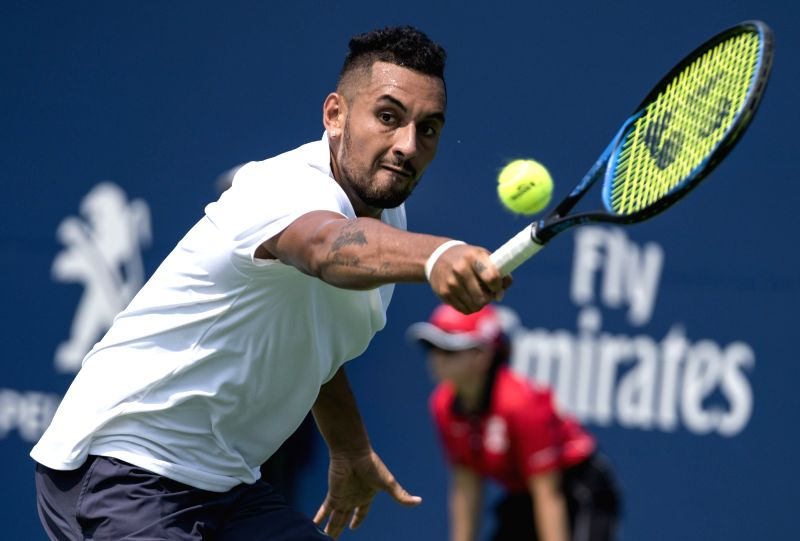 TORONTO, Aug. 8, 2018 - Nick Kyrgios of Australia returns a shot to Stan Wawrinka of Switzerland during the men's first round match at the 2018 Rogers Cup in Toronto, Canada, Aug. 7, 2018. Stan ...