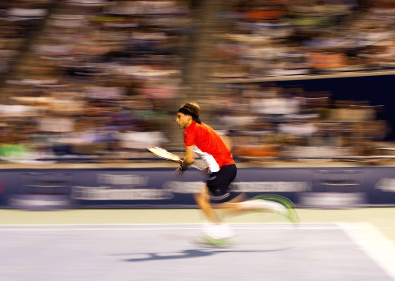 David Ferrer of Spain tries to return the ball during the quarterfinal of men's singles against Roger Federer of Switzerland at the 2014 Rogers Cup in Toronto, ...