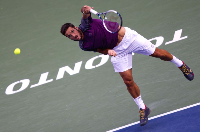 Feliciano Lopez of Spain serves during the quarterfinal of men's singles against Milos Raonic of Canada at the 2014 Rogers Cup in Toronto, Canada, Aug. 8, 2014. ...