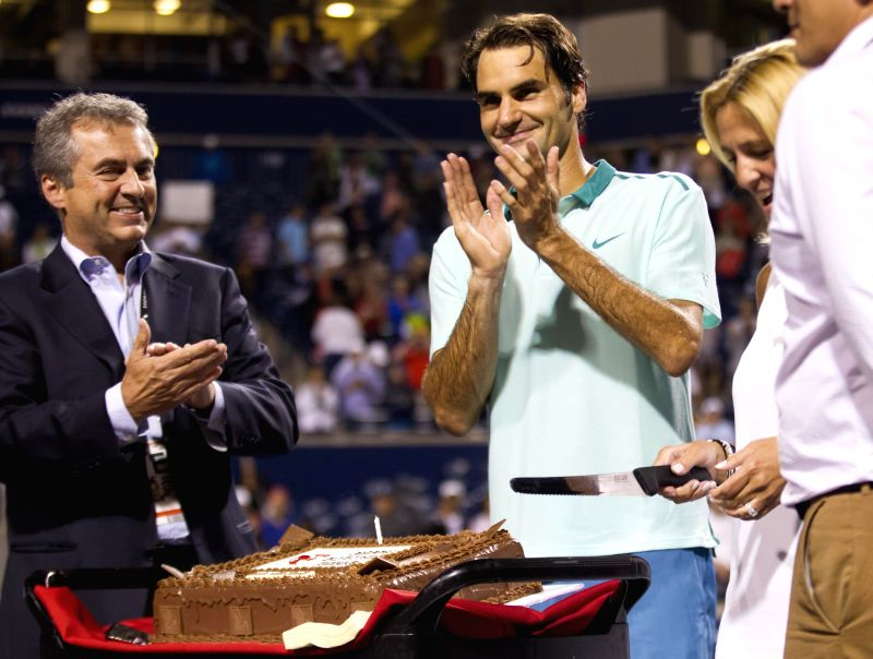 Roger Federer (C) of Switzerland celebrates birthday after the quarterfinal of men's singles against David Ferrer of Spain at the 2014 Rogers Cup in Toronto, Canada,